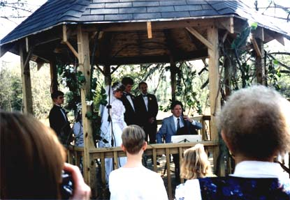 The shaded wooden gazebo serves as mini-stage  for the ceremony. Here cellist Harry Wimmer plays the gigantic C Major Bach Prelude for bride, groom and audience.